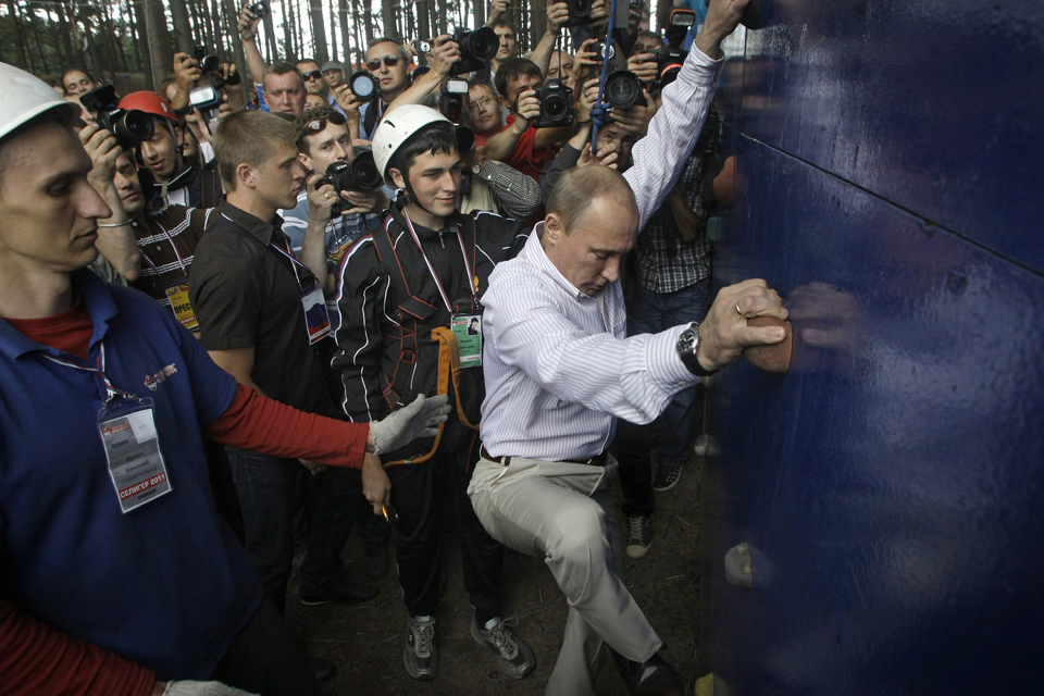Russian Prime Minister Vladimir Putin climbs on a wall during his visit to the Seliger 2011 National Youth Forum near Lake Seliger, Tver region, Russia, 01 August 2011